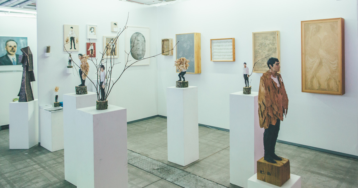 Exhibition space at the Discovery Art Fair,Cologne, Germany, showing sculptures by sculptures Edvardas Racevicius and art works by Urs Bumke (presented by Alte Baeckerei, Greifswald / Germany)