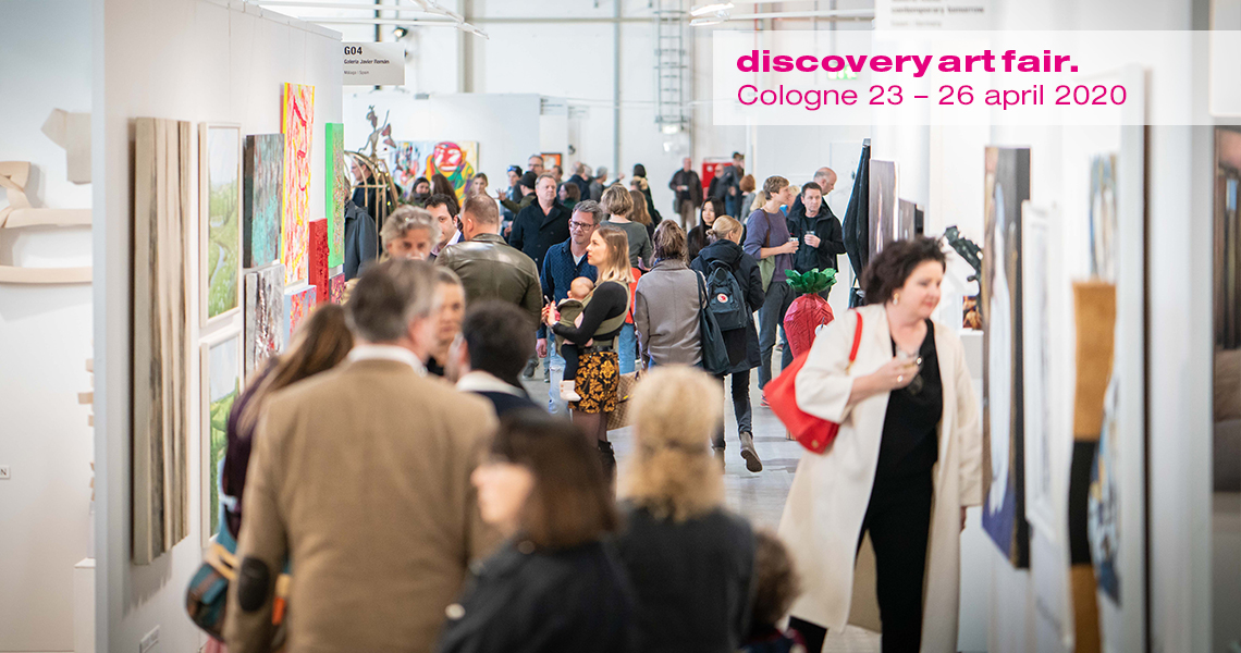 Visitors at DAF art fair Cologne moving between exhibitor/galleries booths