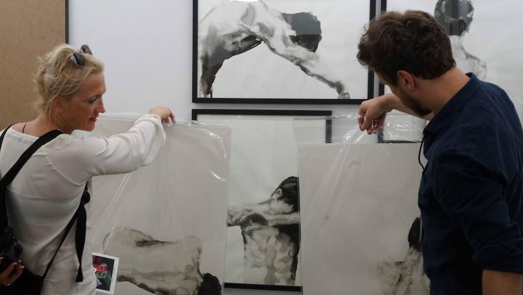 artist selling art at art fair cologne