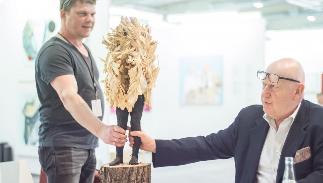 art fair exhibitor selling art and art fair curator
