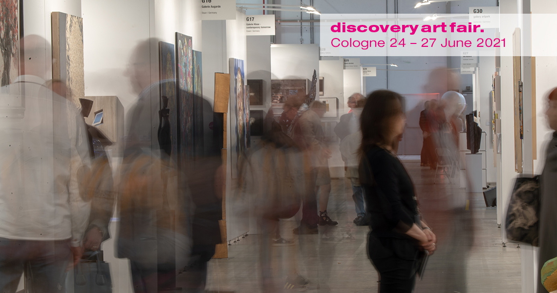 Visitors view contemporary art at Discovery Art Fair in Cologne